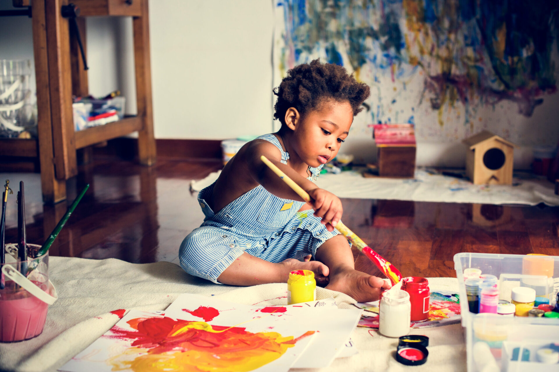 child painting indoors